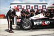 Will Power affixes the Verizon P1 Award emblem for winning the pole for the Firestone 600 at Texas Motor Speedway -- Photo by: Chris Jones