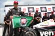 Will Power with the Verizon P1 Award flag for winning the pole position for the Firestone 600 at Texas Motor Speedway -- Photo by: Chris Jones