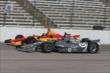 Tony Kanaan and Sebastian Saavedra go wheel-to-wheel during practice for the Firestone 600 at Texas Motor Speedway -- Photo by: Chris Jones