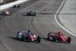 Scott Dixon and Takuma Sato go side-by-side into Turn 3 during the evening practice session at Texas Motor Speedway -- Photo by: Chris Jones