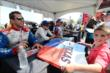 Justin Wilson signs an autograph in the INDYCAR Fan Village at Texas Motor Speedway -- Photo by: Chris Owens