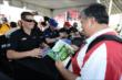 Ryan Briscoe signs autographs in the INDYCAR Fan Village at Texas Motor Speedway -- Photo by: Chris Owens