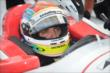 Justin Wilson gets focused prior to practice for the Firestone 600 at Texas Motor Speedway -- Photo by: Chris Owens