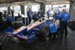 Team Penske go to work on Helio Castroneves' car in the Texas Motor Speedway paddock -- Photo by: Chris Owens
