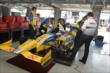 The Andretti Autosport tam go to work on Marco Andretti's car in the Texas Motor Speedway paddock -- Photo by: Chris Owens