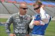 Tony Kanaan and Ryan Briscoe chat on pit lane prior to qualifications for the Firestone 600 at Texas Motor Speedway -- Photo by: Chris Owens