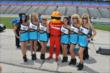 The UFD Girls pose with the Firestone Firehawk during qualifications for the Firestone 600 at Texas Motor Speedway -- Photo by: Chris Owens