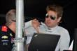 Will Power reviews data with his team after qualifications for the Firestone 600 at Texas Motor Speedway -- Photo by: Chris Owens
