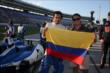 Carlos Huertas flies the Colombian flag during prerace ceremonies for the Firestone 600 -- Photo by: Chris Jones