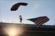 The American flag arrives via paratrooper during prerace ceremonies for the Firestone 600 -- Photo by: Chris Jones