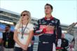 Graham Rahal and girlfriend, Courtney Force, during the pre-race national anthem at Texas Motor Speedway -- Photo by: Chris Jones