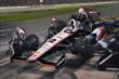 Team Penske goes to work on Will Power's machine during an early stop in the Firestone 600 -- Photo by: Chris Owens