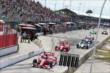 Cars leave pit lane as the green flies to start for the Honda Indy Toronto -- Photo by: Chris Jones