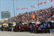 A great crowd swells as pit lane comes to life prior to practice for the Honda Indy Toronto -- Photo by: Chris Jones