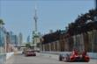 The field streaks down the backstretch during practice for the Honda Indy Toronto -- Photo by: Chris Owens