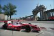 Marco Andretti passes by the Princes' Gate at Turn 1 during practice for the Honda Indy Toronto -- Photo by: Eric Anderson