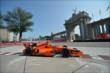 Simon Pagenaud passes by the Princes' Gate in Turn 1 during practice for the Honda Indy Toronto -- Photo by: Eric Anderson