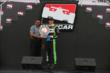 Sebastien Bourdais accepts the Verizon P1 Award from Gopi Sapra during pre-race ceremonies for Race 1 of the Honda Indy Toronto -- Photo by: Chris Jones
