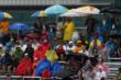 The dedicated race fans of Toronto waiting out the rain on Saturday -- Photo by: Chris Jones
