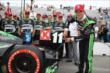 Sebastien Bourdais affixes the Verizon P1 Award emblem for winning the pole for Race 1 of the Honda Indy Toronto -- Photo by: Chris Jones
