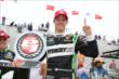 Sebastien Bourdais displays the Verizon P1 Award for winning the pole for Race 1 of the Honda Indy Toronto -- Photo by: Chris Jones