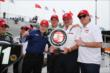Sebastien Bourdais with KVSH Racing owners Sulli Sullivan, Kevin Kalkhoven, and Jimmy Vasser after winning the pole for Race 1 of the Honda Indy Toronto -- Photo by: Chris Jones