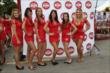 The Toronto Sun Grid Girls are all smiles prior to Race 1 of the Honda Indy Toronto -- Photo by: Chris Jones