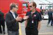 Arie Luyendyk chats with 1999 Indianapolis 500 winner Kenny Brack in the Toronto paddock -- Photo by: Chris Jones