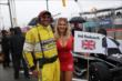 A Toronto Sun Grid Girl greets an INDYCAR Official on the grid during pre-race ceremonies for Race 1 of the Honda Indy Toronto -- Photo by: Chris Jones