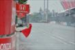 The red flag is waived halting attempts to start Race 1 of the Honda Indy Toronto on Saturday -- Photo by: Chris Owens