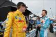 Ryan Hunter-Reay and James Hinchcliffe chat on pit lane prior to the attempted start of Race 1 of the Honda Indy Toronto -- Photo by: Chris Owens