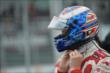 Soctt Dixon tightens the straps on his helmet prior to the attempted start of Race 1 of the Honda Indy Toronto -- Photo by: Eric Anderson