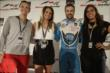 James Hinchcliffe with several members of the Canadian Women's Hockey Team -- Photo by: Shawn Gritzmacher