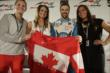 James Hinchcliffe exchanges a jersey with members of the Canadian Women's Hockey Team -- Photo by: Shawn Gritzmacher