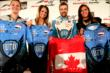 James Hinchcliffe exchanges United Fiber and Data crew shirts for a Canada women's Olympic hockey team jersey with (from left) Jennifer Wakefield, Meaghan Mikkelson and Natalie Spooner -- Photo by: Shawn Gritzmacher
