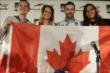 James Hinchcliffe with members of the Canadian Women's Hockey Team -- Photo by: Shawn Gritzmacher