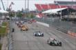 Sebastien Bourdais leads the field to the green flag to start Race 1 of the Honda Indy Toronto -- Photo by: Chris Jones