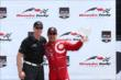 Tony Kanaan accepts his 3rd Place trophy for Race 1 of the Honda Indy Toronto -- Photo by: Chris Jones