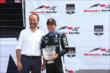 Helio Castroneves accepts his 2nd Place trophy for Race 1 of the Honda Indy Toronto -- Photo by: Chris Jones