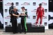 Sebastien Bourdais accepts his winner's trophy for Race 1 of the Honda Indy Toronto -- Photo by: Chris Jones