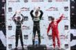 The Honda Indy Toronto Race 1 podium of Sebastien Bourdais, Helio Castroneves, and Tony Kanaan -- Photo by: Chris Jones