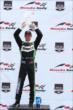 Sebastien Bourdais lifts his winner's trophy for Race 1 of the Honda Indy Toronto -- Photo by: Chris Jones