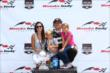 Sebastien Bourdais celebrates his Honda Indy Toronto Race 1 victory on the podium with his family. -- Photo by: Chris Jones