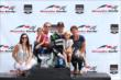 Sebastien Bourdais with his family after winning Race 1 of the Honda Indy Toronto -- Photo by: Chris Jones