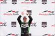 Sebastien Bourdais raises his winner's trophy for Race 1 of the Honda Indy Toronto -- Photo by: Chris Jones