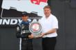 Helio Castroneves is presented with the Verizon P1 Award for being awarded the pole position for Race 2 of the Honda Indy Toronto -- Photo by: Chris Jones