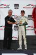 Mike Conway accepts his winner's trophy for Race 2 of the Honda Indy Toronto -- Photo by: Chris Jones