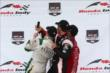 The podium of Mike Conway, Tony Kanaan, and Will Power take a selfie on the podium following Race 2 of the Honda Indy Toronto -- Photo by: Chris Jones