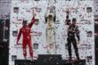 The Honda Indy Toronto Race 2 podium of Mike Conway, Tony Kanaan, and Will Power raise their trophies in Victory Circle -- Photo by: Chris Jones