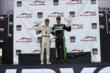 Honda Indy Toronto race winners Sebastien Bourdais (Race 1) and Mike Conway (Race 2) hoist their winner's trophies -- Photo by: Chris Jones